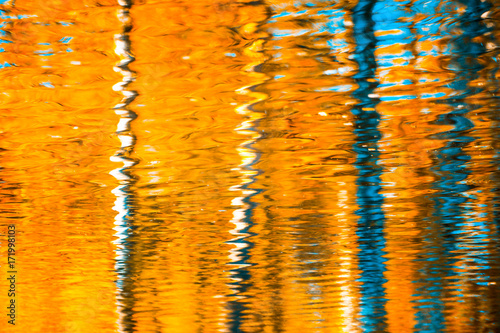 Fototapeten Wasserfalle reflections in the water, abstract autumn background