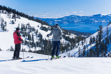 Two Middle Aged Men On Skis Lo...