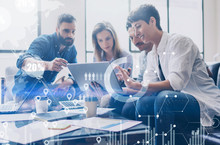 Concept Of Digital Diagram,graph Interfaces,virtual Screen,connections Icon On Blurred Background.Coworking Team At Business Meeting.Group Of Colleagues Working With Startup Project In Modern Office.