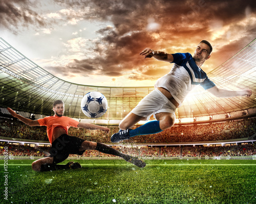 Canvas Print Football scene with competing football players at the stadium