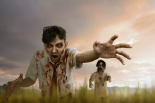 Two Asian Zombie Man With Mad Face And Dirty Hand Standing