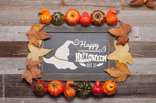 Pumpkins And Fall Leaves On Wooden Background Halloween