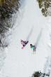 2 people on a ski run