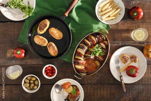 Foto op Aluminium Picknick Ratatouille, chickpeas cutlets, lemonade, various snacks. Vegetarian dinner table concept