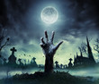 canvas print picture Zombie Hand Rising Out Of A Graveyard