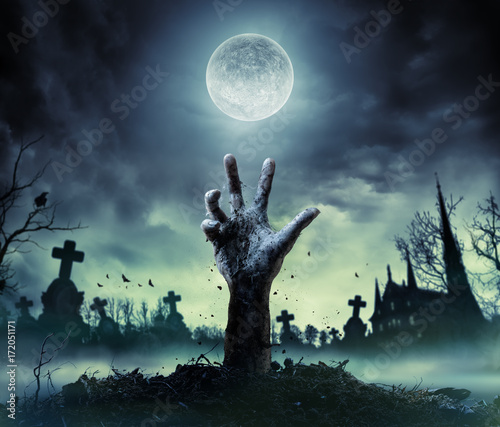 Zombie Hand Rising Out Of A Graveyard Fotobehang