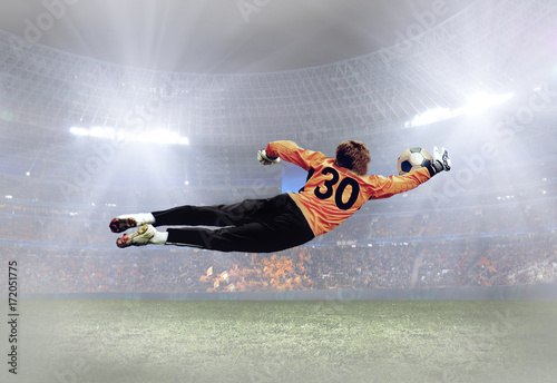 Fototapety, obrazy: Soccer player with ball in action on field of stadium