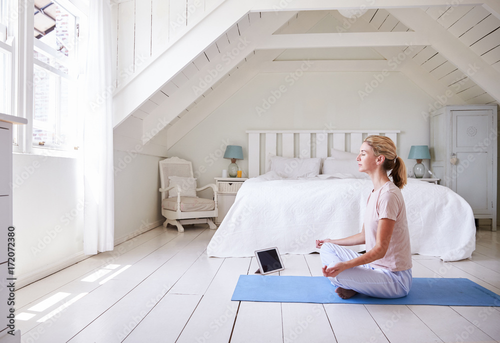 Fototapety, obrazy: Woman With Digital Tablet Using Meditation App In Bedroom