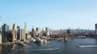 Aerial view of the Brooklyn bridge through the East river to Manhattan in New York, America. Boat riding on the shore.