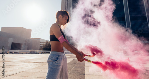 Woman with smoke grenade