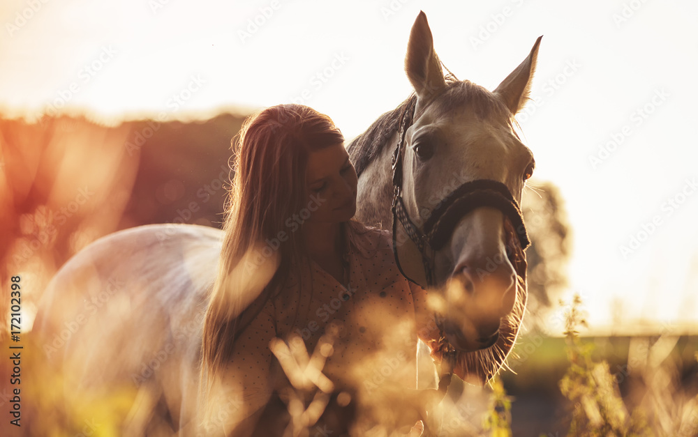 Fototapety, obrazy: Woman with her horse at sunset, autumn scene