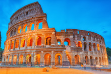 Beautiful Landscape Of The Colosseum In Rome- One Of Wonders Of The World  In The Evening Time. Italy.