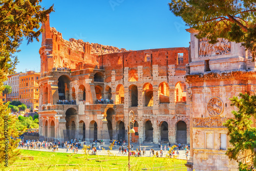 Beautiful landscape of the Colosseum in Rome- one of wonders of the world  in the morning time with tourists near him Wallpaper Mural