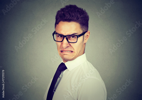 Portrait of a disgusted young business man looking at camera Canvas Print