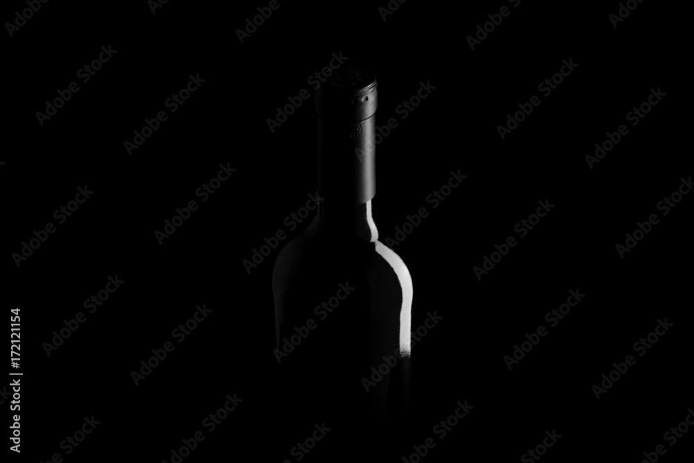 wine bottle on black background - black and white photo