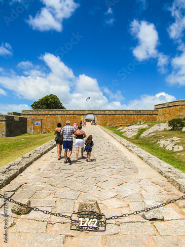 Fotografie, Obraz  Tourists entering the Fortress of Santa Teresa in Rocha, Uruguay