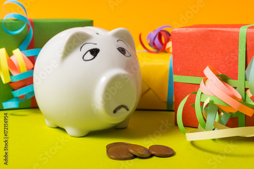 Photo  Piggy Bank with gift boxes, worried about money