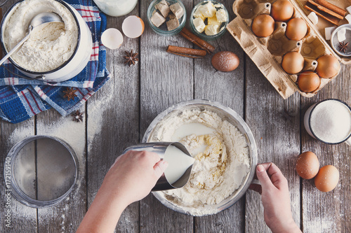 Fotografie, Obraz  Making dough top view on rustic wood background