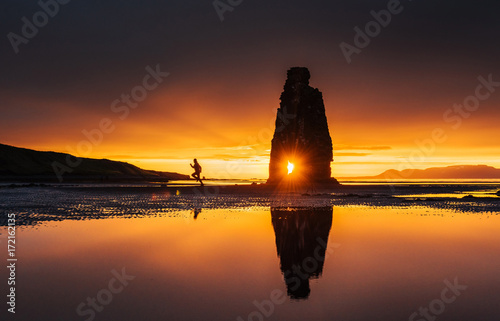 Obraz Is a spectacular rock in the sea on the Northern coast of Iceland. On this photo Hvitserkur reflects in the sea water after the midnight sunset - fototapety do salonu
