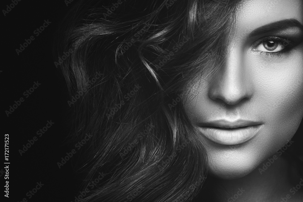 Fototapeta Woman with curly hair and beautiful make-up