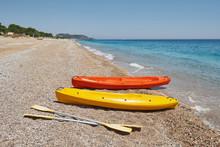 Colorful Kayaks On The Beach. ...