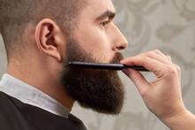 Hand Of Barber Brushing Beard. Barbershop Customer, Side View. Beard Grooming Tips For Beginners.