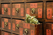 Details Of Chinese Medicine Shop With An Open Drawer And Herbs
