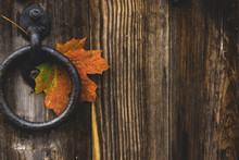 Autumn Maple Leaf Hanging On Old Handle Of Vintage Style Wooden Door, Copy Space