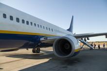Passengers Boarding On A Plane