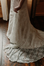 Woman Holding Wedding Dress