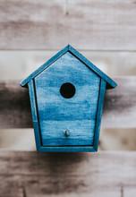 Blue Bird House On A Wood Table