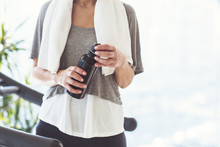 Woman Taking A Break To Drink Some Water During The Workout