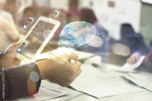 Fotografie, Obraz businessman hold mobile showing light bulb web engineering , Business idea conce