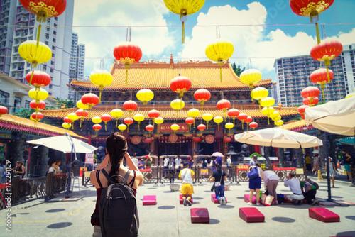 female traveler photographing temples at Wong Tai Sin Temple Hong Kong landmark