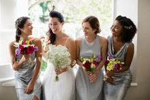 Bride And Bridesmaids Standing With Bouquet