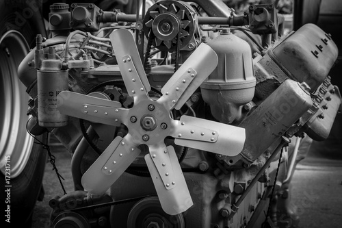 Photo exhibition fan of engine aggregate of agricultural machines, black and white