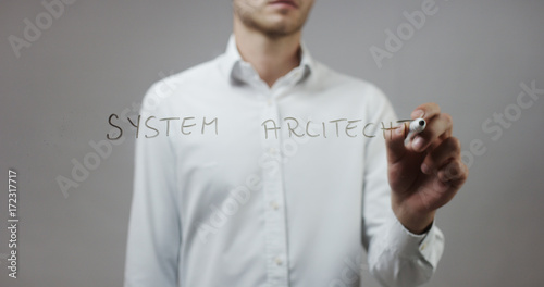 System architect, Man Writing on Glass