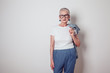 canvas print picture - Stylish old woman in white t-shirt. Mock up.