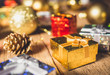 Christmas present box with golden ball and pine cone with decoration for christmas day