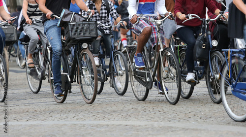 people riding bicycles in Amsterdam in the Netherlands