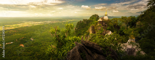 Panoramic shot : Wat Chalermprakiat Prajomklao Rachanusorn chedis on the mountain top, Lampang province, Thailand