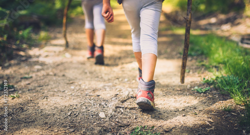 Fotografía Children hiking in mountains or forest with sport hiking shoes.