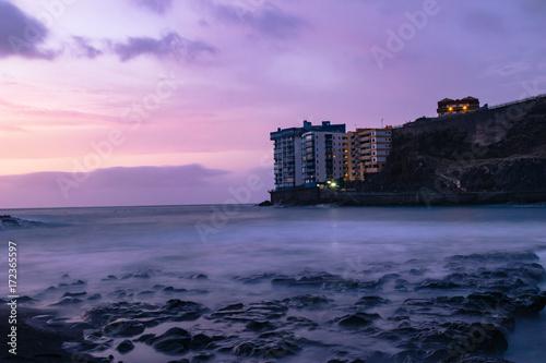 Fotobehang Purper Sunset of long exposure in Mesa del Mar beach, Tacoronte, Tenerife, Canary Islands, Spain.