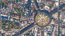 Aerial View, Road Roundabout, Expressway With Car Lots In The City In Thailand.  Beautiful Street , Downtown, Cityscape, Top View. Background