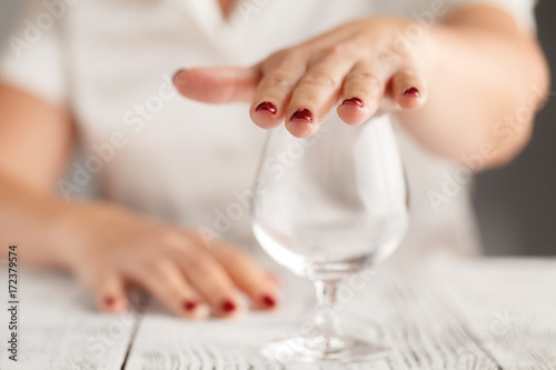 Valokuva  Cropped image of woman showing stop gesture and refusing to drink