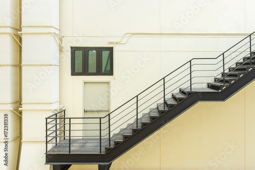 Tuinposter Trappen stair for fire escape with the steel railing and ladder