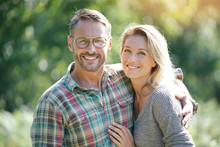 Portrait Of Mature Couple Enjoying Sunny Day In Nature
