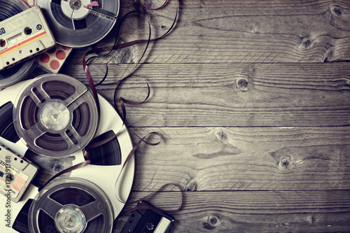 Old audio reels and cassette tape background Wallpaper Mural