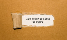 The Text Its Never Too Late To Start Appearing Behind Torn Brown Paper