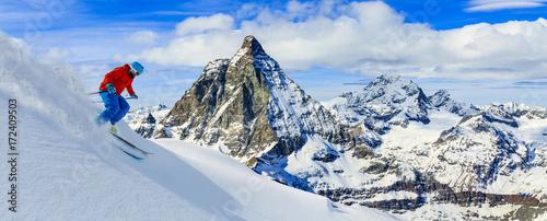 Skiing with amazing view of swiss famous mountains in beautiful winter snow. Matterhorn, Zermatt, Swiss Alps.